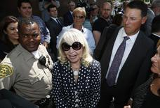 Shelly Sterling, 79, (C) smiles after leaving court in Los Angeles, California July 28, 2014.   REUTERS/Lucy Nicholson