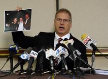 Jeff Herman, attorney for the anonymous victim in the allegation of child sexual abuse by Hollywood executives, displays a partially blacked-out photograph during a news conference in Beverly Hills, California May 5, 2014. REUTERS/Kevork Djansezian