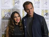 """Cast members Megan Fox and Will Arnett pose at a press line for the movie """"Teenage Mutant Ninja Turtles"""" during the 2014 Comic-Con International Convention in San Diego, California July 24, 2014.  REUTERS/Mario Anzuoni"""
