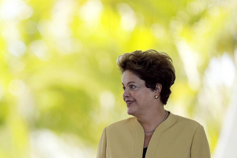 Brazil's President Dilma Rousseff looks on during a welcoming ceremony for EU Commission President Jose Manuel Barroso before a meeting at the Alvorada Palace in Brasilia July 18, 2014. REUTERS/Ueslei Marcelino