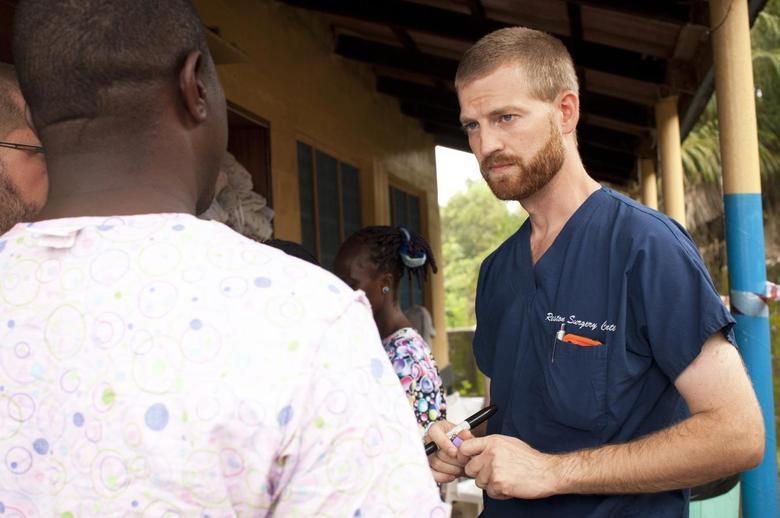 Dr. Kent Brantly (R) speaks with colleagues at the case management center on the campus of ELWA Hospital in Monrovia, Liberia in this undated handout photograph courtesy of Samaritan's Purse.  REUTERS/Samaritan's Purse/Handout via Reuters