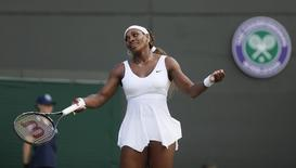 Serena Williams of the U.S. reacts during her women's singles tennis match against Alize Cornet of France at the Wimbledon Tennis Championships, in London June 28, 2014.                     REUTERS/Stefan Wermuth