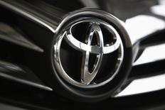 A Toyota logo is seen on a car inside a showroom at a Toyota dealership in Warsaw, in this April 11, 2014 file photo. REUTERS/Kacper Pempel/Files