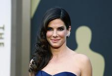 """Sandra Bullock, best actress nominee for her role in """"Gravity,"""" wearing an Alexander McQueen gown with Lorraine Schwartz jewels arrives at the 86th Academy Awards in Hollywood, California March 2, 2014.   REUTERS/Lucas Jackson"""