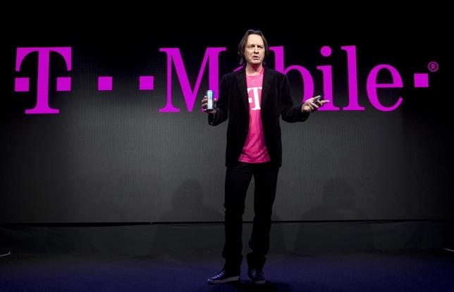 T-Mobile CEO John Legere speaks during a news conference at the 2014 International Consumer Electronics Show (CES) in Las Vegas, Nevada, in this file photo taken January 8, 2014.  REUTERS/Steve Marcus/Files