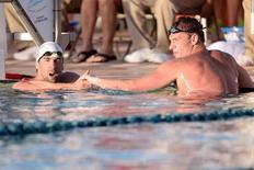Apr 24, 2014; Mesa, AZ, USA; Michael Phelps and Ryan Lochte after the men's 100m butterfly race at the 2014 USA Swimming Grand Prix Series at Skyline Aquatic Center.  Joe Camporeale-USA TODAY Sports