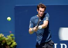 Andy Murray plays a backhand against Nick Kyrgios (not pictured) on day three of the Rogers Cup tennis tournament at Rexall Centre on August 6, 2014.  USA TODAY Sports/Peter Llewellyn