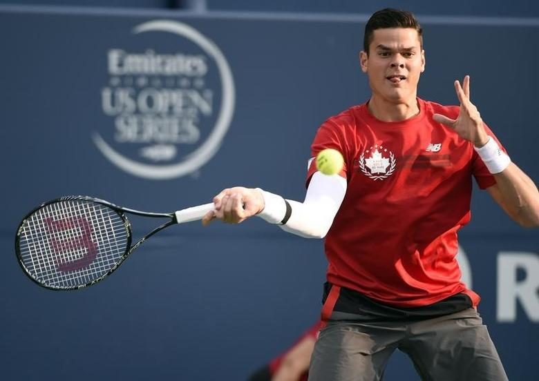 Aug 6, 2014; Toronto, Ontario, Canada; Milos Raonic (CAN) hits a forehand against Jack Sock (USA) on day three of the Rogers Cup tennis tournament at Rexall Centre. Mandatory Credit: Peter Llewellyn-USA TODAY Sports - RTR41I16