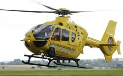 An East Anglian air ambulance takes off from Cambridge airport in eastern England August 6, 2014.  REUTERS/Chris Radburn/pool