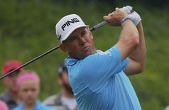 Lee Westwood of England watches his tee shot on the 16th hole during the first round of the 2014 PGA Championship at Valhalla Golf Club in Louisville, Kentucky, August 7, 2014.  REUTERS/Brian Snyder