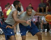 Jul 30, 2014; Las Vegas, NV, USA; Team USA guard Kevin Durant (right) dribbles the ball against guard James Harden (left) during a team practice session at Mendenhall Center. Mandatory Credit: Stephen R. Sylvanie-USA TODAY Sports