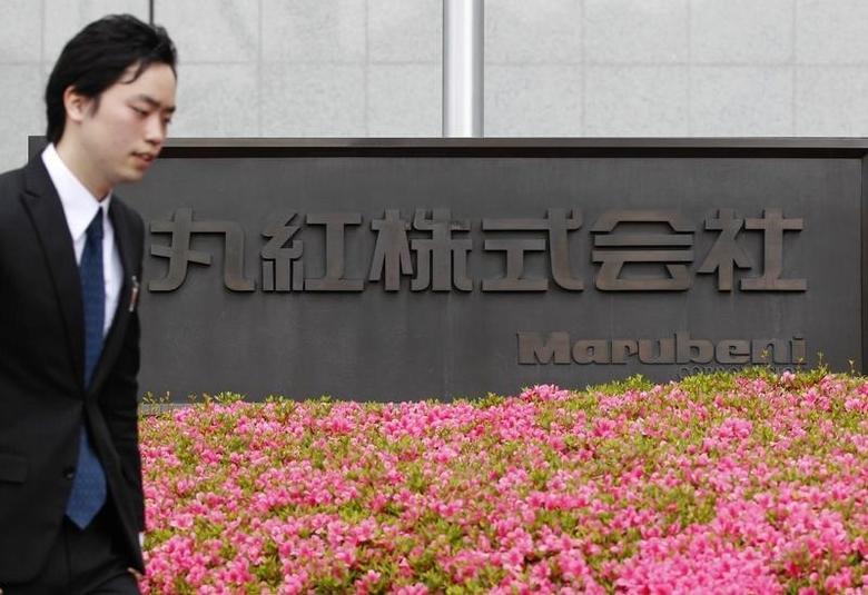 A man passes a logo of Japanese trading house Marubeni Corp outside its company headquarters in Tokyo May 29, 2012.  REUTERS/Yuriko Nakao