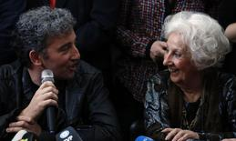 Estela de Carlotto (R), president of human rights organization Abuelas de Plaza de Mayo (Grandmothers of Plaza de Mayo), smiles as she talks to her grandson Ignacio Hurban during a news conference in Buenos Aires, August 8, 2014. REUTERS/Marcos Brindicci