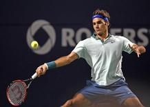1Aug 8, 2014; Toronto, Ontario, Canada; Roger Federer (SUI) plays a forehand against David Ferrer (ESP) on day five of the Rogers Cup tennis tournament at Rexall Centre. Mandatory Credit: Peter Llewellyn-USA TODAY Sports - RTR41RRE