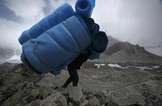 A porter carries mattresses back from Everest base camp, approximately 5,300 meters above sea level, in Solukhumbu District May 6, 2014. REUTERS/Navesh Chitrakar