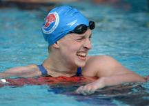 Katie Ledecky reacts after setting a meet record of 3:59.89 in a womens 400m freestyle heat in the 2014 USA National Championships at William Woollett Jr. Aquatics Complex. Kirby Lee-USA TODAY Sports