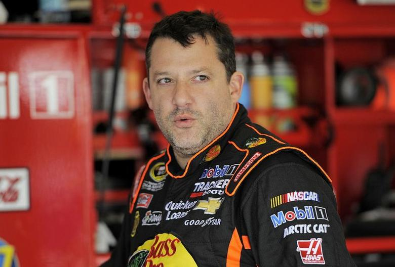 NASCAR Sprint Cup Series driver Tony Stewart speaks with crew members during practice for the Daytona 500 qualifying at Daytona International Speedway in Daytona Beach, Florida, in this file photo taken February 16, 2013.    REUTERS/Brian Blanco/Files
