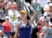 Agnieszka Radwanska (POL) reacts after winning against Venus Williams (USA) in the final of the Rogers Cup tennis tournament at Uniprix Stadium. Stadium. Eric Bolte-USA TODAY Sports