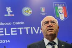 Recém-eleito presidente da federação italiana de futebol em Roma. 11/08/2014. REUTERS/Alessandro Bianchi