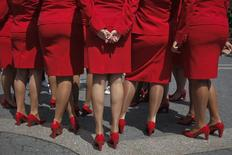 Crew members of Virgin Atlantic Airways stand together in Union Square during a promotional event by the British-owned airline to celebrate the Diamond Jubilee of Queen Elizabeth in New York June 2, 2012.  REUTERS/Eduardo Munoz