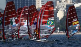 Competitors stand on their windsurfing boards at the women's RS-X sailing class during the first test event for the Rio 2016 Olympic Games at the Guanabara Bay in Rio de Janeiro August 3, 2014.  REUTERS/Sergio Moraes