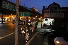 People make their way on the streets of the neighborhood of Queens in New York August 8, 2014.  REUTERS/Eduardo Munoz