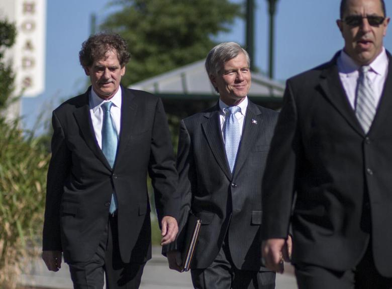 Former Virginia Governor Robert McDonnell arrives with his legal team for his trial in Richmond, Virginia, July 28, 2014.  REUTERS/Jay Westcott
