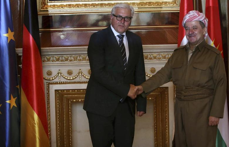 Iraqi Kurdistan President Masoud Barzani (R) shakes hands with Germany's Foreign Minister Frank-Walter Steinmeier in Arbil, north of Baghdad August 16, 2014. REUTERS/Stringer