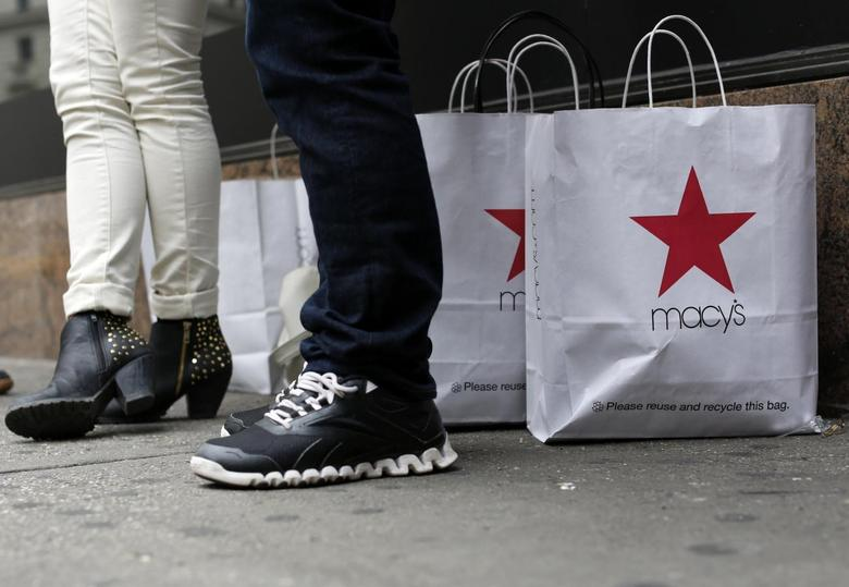 Customers stand outside Macy's store in New York, in this April 11, 2013 file photo. REUTERS/Brendan McDermid/Files