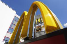 A logo of McDonald's Corp's is on display outside its restaurant on the outskirts of Moscow July 25, 2014. REUTERS/Maxim Shemetov