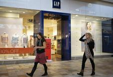 Passers-by walk next to a Gap store in Broomfield, Colorado February 27, 2014. REUTERS/Rick Wilking