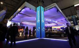 Visitors walk past the Qualcomm stand at the Mobile World Congress in Barcelona in this February 24, 2014 file photo. REUTERS/Albert Gea/Files