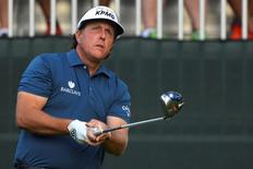 Aug 21, 2014; Paramus, NJ, USA; Phil Mickelson watches hits tee shot on the first hole during the first round of The Barclays golf tournament at Ridgewood Country Club. Mandatory Credit: Tommy Gilligan-USA TODAY Sports