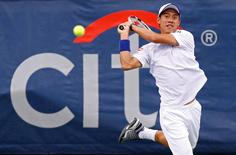 Kei Nishikori hits a backhand against Richard Gasquet (not pictured) on day five of the Citi Open tennis tournament at the Fitzgerald Tennis Center. Gasquet won 6-1, 6-4. Mandatory Credit: Geoff Burke-USA TODAY Sports