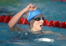Katie Ledecky celebrates after setting a world record of 3:58.86 in the womens 400m freestyle at the 2014 USA National Championships at William Woollett Jr. Aquatics Complex. Kirby Lee-USA TODAY Sports