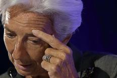 Глава МВФ Кристин Лагард на пресс-конференции в Париже 18 июля 2014 года. Глава МВФ Кристин Лагард оказалась фигурантом расследования в родной Франции по делу о коррупции в 2008 году, когда она занимала пост министра финансов. REUTERS/Philippe Wojazer