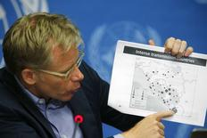 World Health Organization (WHO) Assistant Director General Bruce Aylward holds up a document during a press briefing on WHO's strategy to combat Ebola, at the United Nations headquarters in Geneva August 28, 2014.  REUTERS/Pierre Albouy