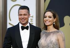 Actors Brad Pitt and Angelina Jolie arrive at the 86th Academy Awards in Hollywood, California March 2, 2014.   REUTERS/Lucas Jackson