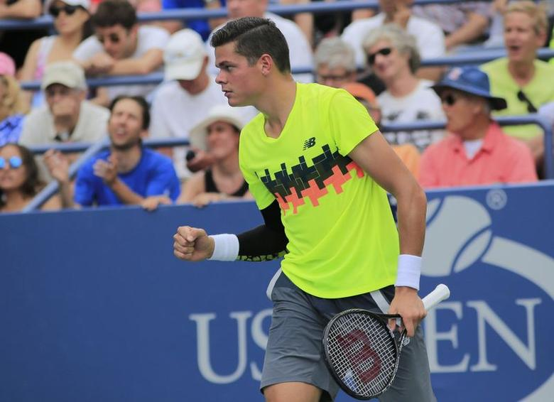 Milos Raonic of Canada reacts after defeating Victor Estrella Burgos of the Dominican Republic during their match at the 2014 U.S. Open tennis tournament in New York, August 30, 2014.   REUTERS/Eduardo Munoz