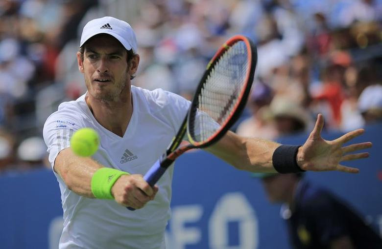 Andy Murray of Britain hits a return to Andrey Kuznetsov of Russia during their match at the 2014 U.S. Open tennis tournament in New York, August 30, 2014. REUTERS/Eduardo Munoz (UNITED STATES  - Tags: SPORT TENNIS)