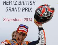 Honda MotoGP rider Marc Marquez of Spain celebrates winning the British Grand Prix at the Silverstone Race Circuit, central England, August 31, 2014.  REUTERS/Darren Staples
