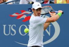 Aug 30, 2014; New York, NY, USA;  Andy Murray (GBR) returns a shot to Andrey Kuznetsov (RUS) on Armstrong Stadium on day six of the 2014 U.S. Open tennis tournament at USTA Billie Jean King National Tennis Center. Anthony Gruppuso-USA TODAY Sports