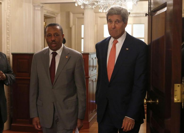 U.S. Secretary of State John Kerry (R) meets with Prime Minister of Libya Abdullah al-Thinni at the State Department in Washington, August 4, 2014. REUTERS/Yuri Gripas