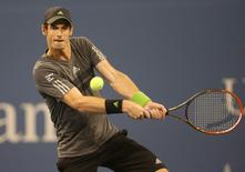 Andy Murray (GBR) returns a shot to Novak Djokovic (SRB) on day ten of the 2014 U.S. Open tennis tournament at USTA Billie Jean King National Tennis Center. Mandatory Credit: Jerry Lai-USA TODAY Sports