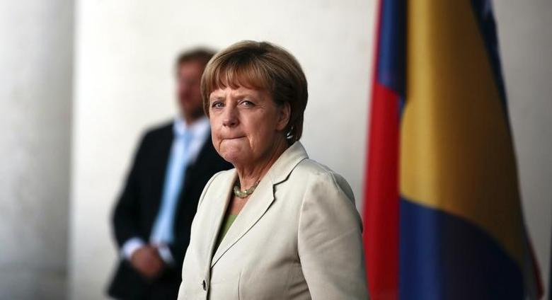 German Chancellor Angela Merkel prepares to welcome participants at the ''West Balkan Conference'' at the chancellery in Berlin August 28, 2014. REUTERS/Markus Schreiber/Pool