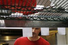 William Luz, who was recently released from the Barnstable County House of Corrections, cooks a diner's order at a restaurant in Sandwich, Massachusetts August 29, 2014.   REUTERS/Brian Snyder