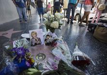 Flowers and mementos are pictured on the star of comedian Joan Rivers on the Walk of Fame in Hollywood, California September 4, 2014. REUTERS/Mario Anzuoni