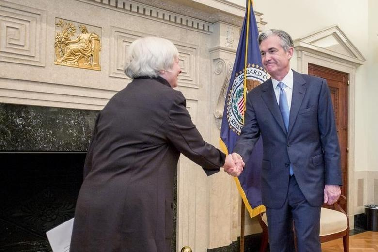 U.S. Federal Reserve Chair Janet Yellen (L) congratulates Fed Governor Jerome Powell at his swearing-in ceremony for a new term on the Fed's board, in Washington in this handout photo taken and released June 16, 2014. REUTERS/U.S. Federal Reserve/Handout via Reuters