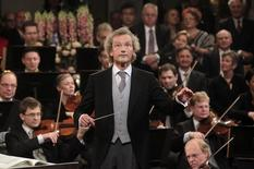 Maestro Franz Welser-Moest conducts the Vienna Philharmonic Orchestra during the traditional New Year's Concert in the Golden Hall of the Vienna Musikverein in Vienna January 1, 2013. REUTERS/Herwig Prammer