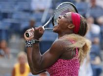 Serena Williams of the U.S. celebrates winning match point against Ekaterina Makarova of Russia during their semi-final match at the 2014 U.S. Open tennis tournament in New York, September 5, 2014.     REUTERS/Adam Hunger